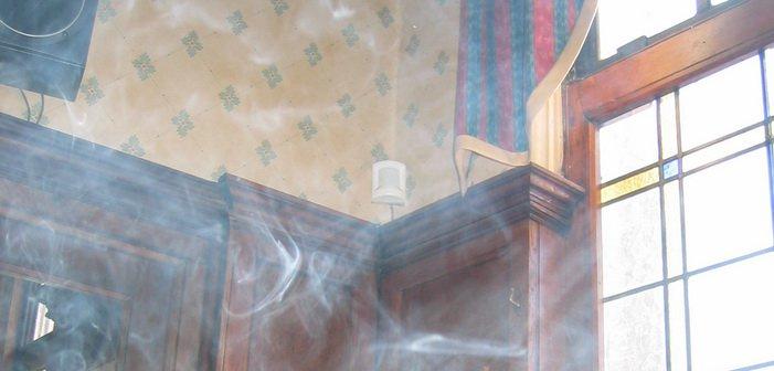 Smoke-by-a-window-in-a-pub