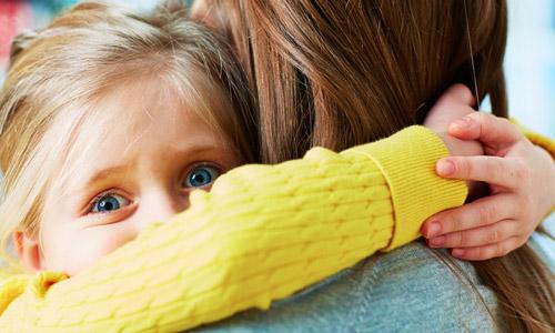 scared-girl-hugging-mother-500